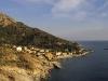 Die untergehende Sonne bringt die Farben der Westküste Elbas zum Leuchten, Elba, Toskana, Italien