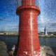 Roter Leuchtturm an der Hafeneinfahrt von Castiglione della Pescaia, Maremma, Toskana, Italien